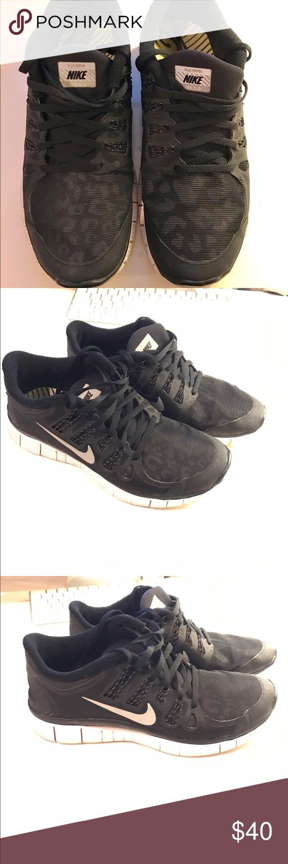 H20 Black Leopard Repel Nike Free 5.0 Black Leopard Nike free runs 5.0 with Metallic Nike swoosh. Gently worn. Great condition. Size 7.5 Nike Shoes Sneakers