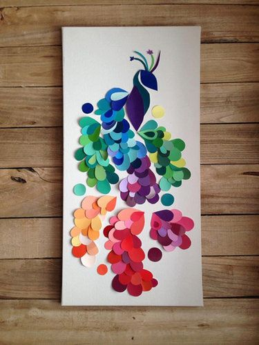 Punch a few shapes in paint chips, pepper them on a piece of paper, and frame it for an awesome piece of art. Source: Etsy user SouthMagnoliaMarket