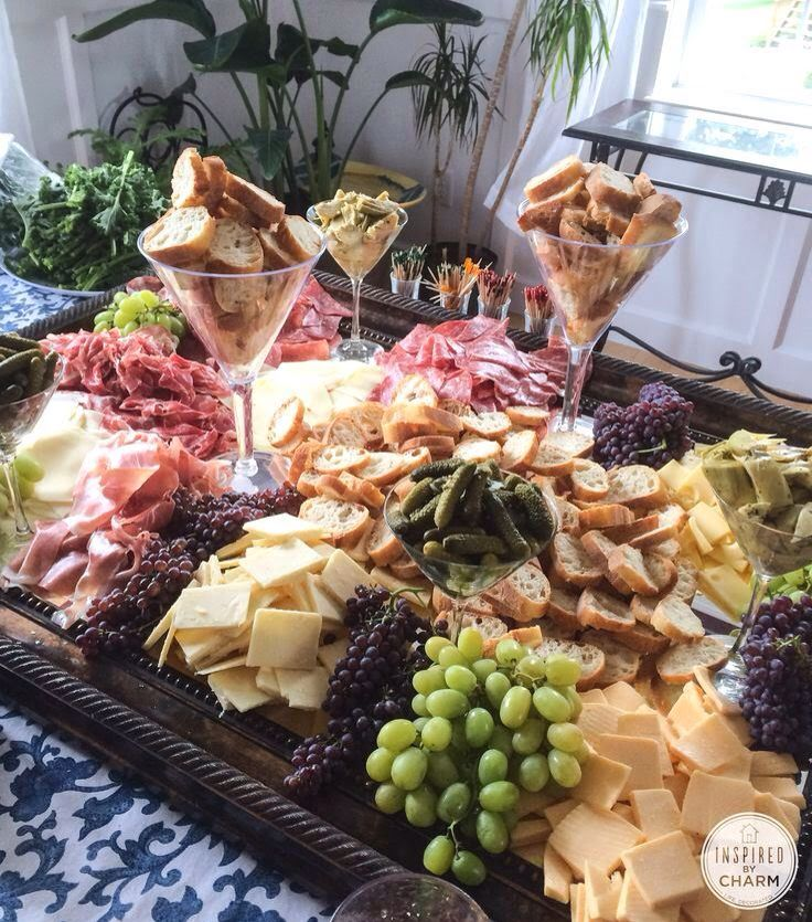 Elegant display of cheese platter.  Love the use of martini glasses to hold the bread.