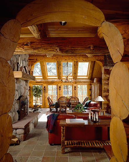 Log home sun rooms sunroom log arch stone fireplace for Log cabin sunrooms