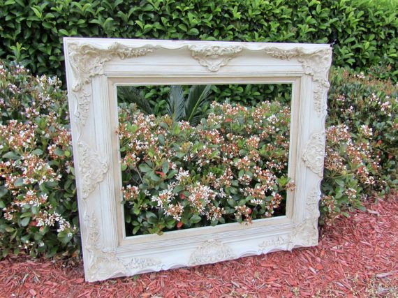 Absolutely gorgeous ornate wood large picture frame. Pictures do not do it justice. Frame will certainly be the focal point of any room. A spectacular find. A gorgeous gift. An awesome photo prop for a wedding or anniversary.  Dimensions: 34 x 30 Inside measurements: 20 x 24