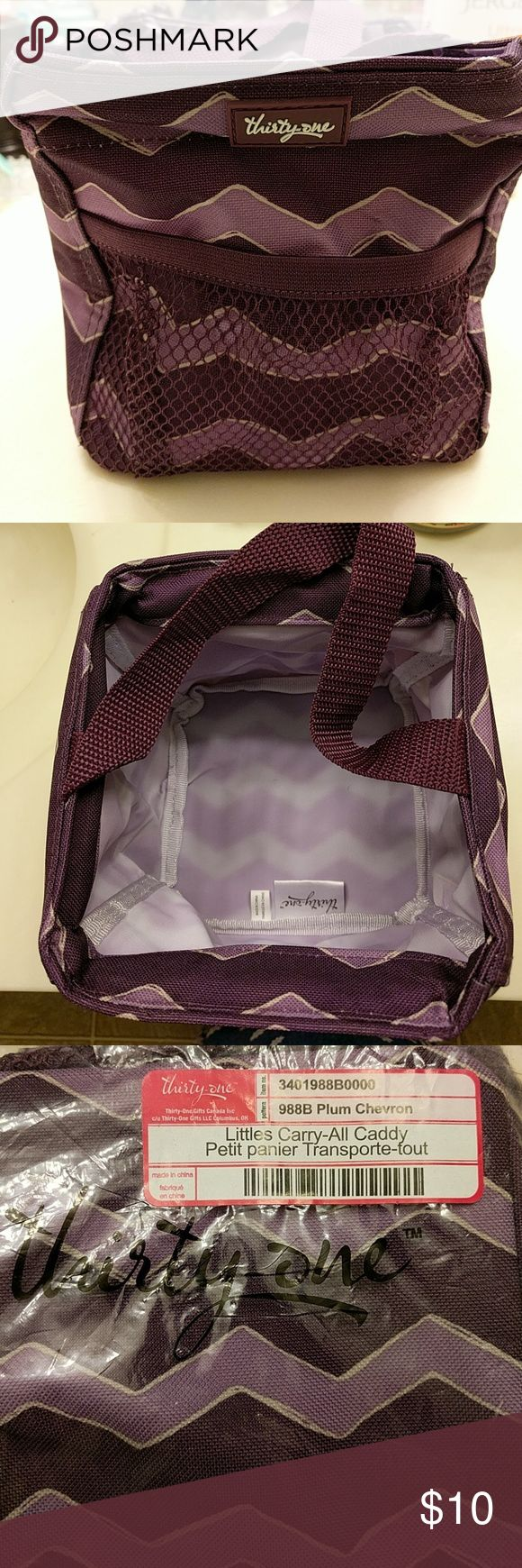 Purple pop-up caddy NWT Small carry-all caddy holds quite a bit. Fun purple chevron print. Perfect for office supplies, makeup, homemade treats, etc. thirty one Bags