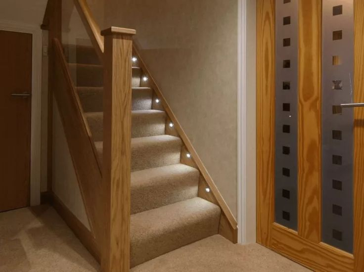 Cladded Oak Newel Posts and Embedded Glass Balustrade