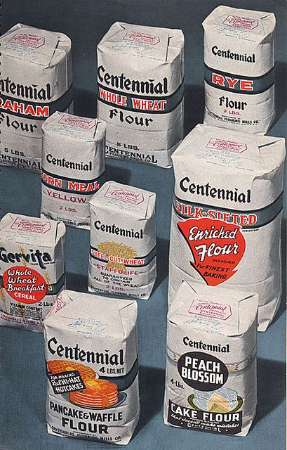 A vintage colour photo ad showing an area of Centennial brand flours and other baking products.