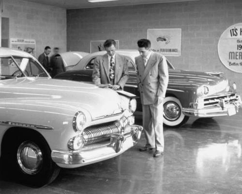 rubyredglitterpumps:    Vyron (Bud) Galbraith (R) buying new Mercury at local dealership.