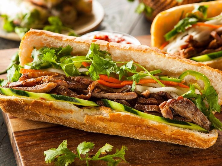 The bánh mì, a sandwich sold at stalls throughout Vietnam, beautifully melds French and Vietnamese ingredients. The exact elements of an authentic bánh mì vary, but there are a few generally agreed-upon ingredients: baguette, ham, mayo, pate, pickled daikon, peppers, and nuoc cham dipping sauce. If you can