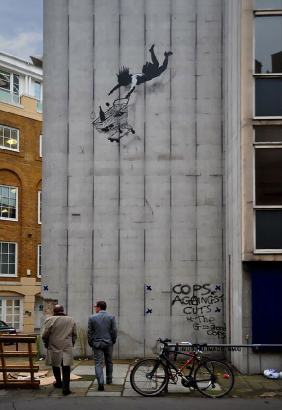 Street art Shop Til You Drop Banksy Style Black Friday Stencil in London