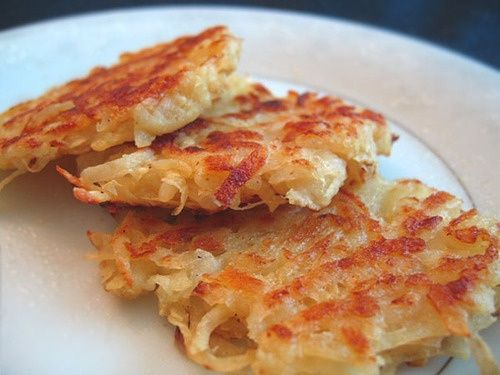 Basic Potato Latkes Recipe   Ingredients: 1 pound Russet potatoes (a very large Russet potato is about ½-¾ pound)  ½ large onion  1 large egg, lightly beaten  (1-2 teaspoons all-purpose flour, optional to help pancakes hold together)  salt + pepper to taste  enough oil and butter to fry