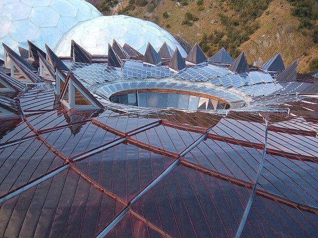 """The fantastic roof of the Core at the Eden Project in Cornwall, near St Austell, UK. The unusual architecture uses """"biomimicry"""" i.e. using natural forms in plants as construction techniques. Apparently this is based on a sunflower head. I loved the light on the roof with the biomes in the background. All built to repurpose an old industrial site - a china clay quarry. A unique place. Image by Richard Brookes. http://fineartamerica.com/featured/core-roof-eden-project-richard-brookes.html"""