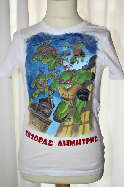 Hand painted boy's t shirt, featuring the Teenage Mutant Ninja Turtles. The colors are non-toxic, water based, permanent fabric colors.