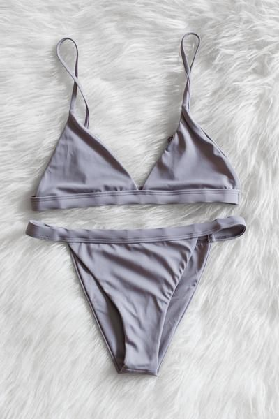 Seamless triangle bikini top with adjustable shoulder straps. Fully lined, not padded. Banded and seamless cheeky bikini bottoms. - 80% Nylon 20% Spandex - Made in USA Returns will not be accepted for