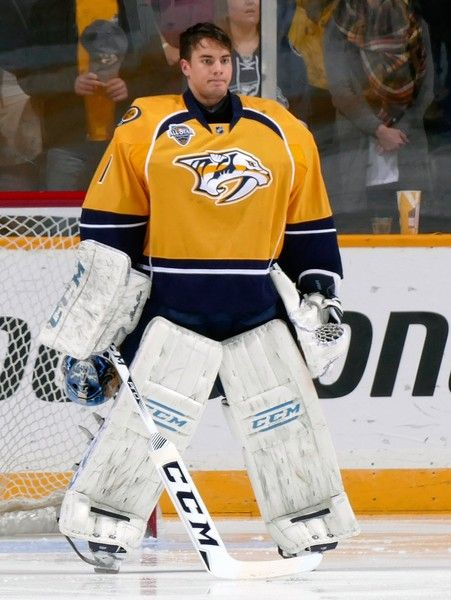 Juuse Saros Photos Photos - Prior to his first career NHL game goalie Juuse Saros #1 of the Nashville Predators stands for the National Anthem prior to the game against the Buffalo Sabres during the first period at Bridgestone Arena on November 28, 2015 in Nashville, Tennessee. - Buffalo Sabres v Nashville Predators