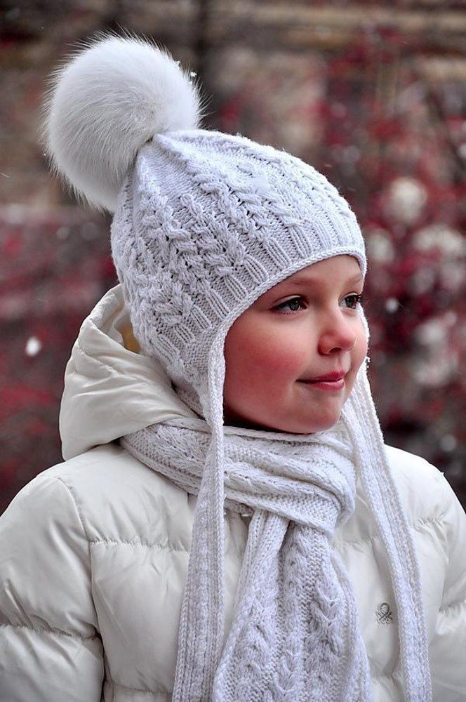 "Stylish Fern Field Hat with earflaps knitted with unusual cable pattern will delight girls of all ages and will provide warmth and attention in any frost!Sizes available: 18-19, 19-19.5 (19.5-20.5, 20.5-21) (21-22, 22-22.8)"" / 46-48, 48-50 (50-52, 52-54) (54-56, 56-58) cmThis pattern is a part of Fern Field e-book.Materials: Mondial Superwool (50g – 125m), – 100, 100 (120, 120) (150, 150) g (without pompon). - needles US 5 - 3.75 mm and US 2½ - 3.0 mm"