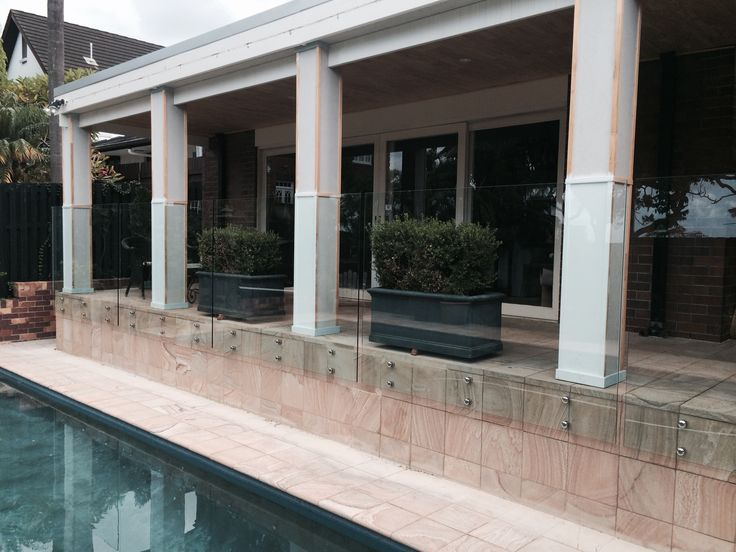 Frameless glass fencing on polished stainless steel standoffs at Clayfield