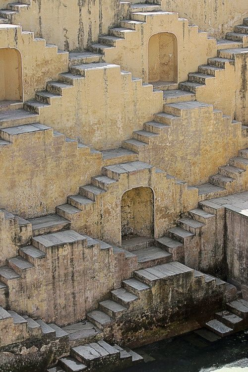 Chand Baori ( a well), is a famous stepwell situated in the village of Abhaneri near Jaipur in the Indian state of Rajasthan. It was built by King Chanda of the Nikumbha Dynasty between 800 and 900 CE and was dedicated to Hashat Mata, Goddess of Joy and Happiness upon completion. Its 3500 narrow steps in 13 stories extend 100 feet (30 m) into the ground, making it one of the deepest (and largest) stepwells in India.