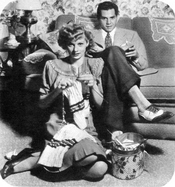 Lucille Ball knitting, while snuggling with an approving Desi