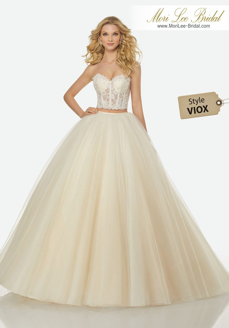 Style VIOX JILLIAN WEDDING DRESSTwo-Piece Gown with Crystal Beaded, Sweetheart, Sheer Lace, Boned Corset Top and Full, Gathered Sparkling Tulle Skirt.Colors: IVORY, IVORY/CHAMPAGNE