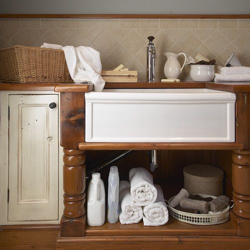 Basic storage under a farmhouse-style laundry sink