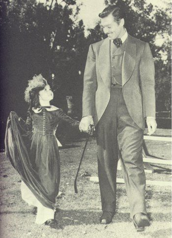 Cammi King (Bonnie Blue) and Clark Gable (Rhett Butler) from Gone With the Wind.