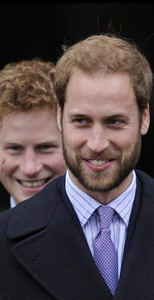 Prince William and Prince Harry [possibly laughing at William's face hair]