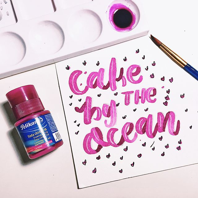 """Been busy all day setting up my new Bullet Journal (yes the third one this year) and practicing lettering with drawing ink. """"Cake by the ocean from @dnce popped up on the playlist and hey, I still love this song 💕😍🙌🏼 #diario_tropical #letteringjournal #cakebytheocean #lettering #pelikan #pink #drawingink"""