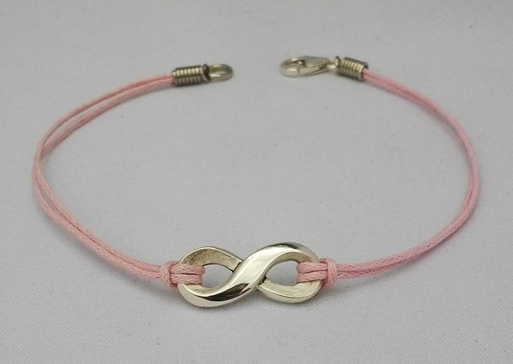 Sterling silver infinity bracelet on leather.