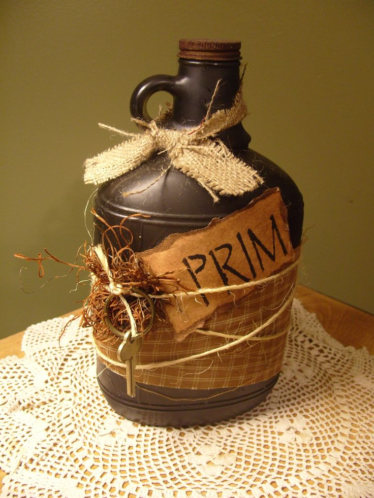 Old wine jug I painted black and wrapped some burlap and string around