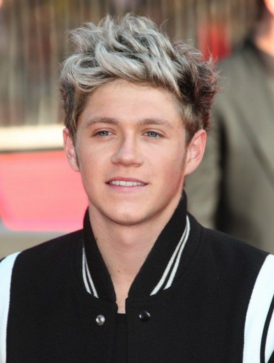 Niall Horan from One Direction aattends the world premiere of One Direction: This Is Us at the Empire Theater in Leicester Square, London, England. Photo copyright Alexandra Glen / Featureflash.