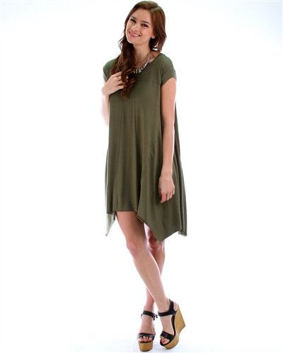 Lost Reverie Oversized T-Shirt Dress: Olive Green  Everyone loves a comfortable oversized t-shirt right?  Yes!  Take it to the next level and pick up our Lost Reverie Oversized T-Shirt Dress in Olive Green.  This olive color t-shirt dress is asymmetrical and features a cute silhouette.  This look is very versatile for all your events.