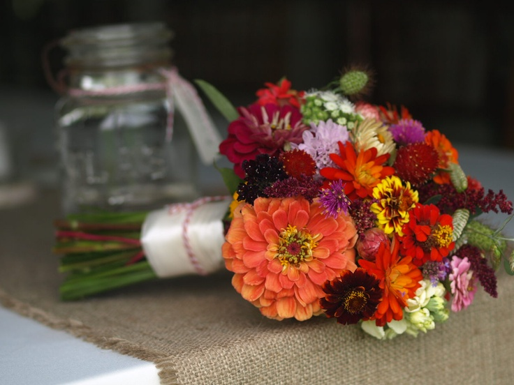 Zinnia bridal bouquet. Tied with silk ribbon and accented with bakers twine.