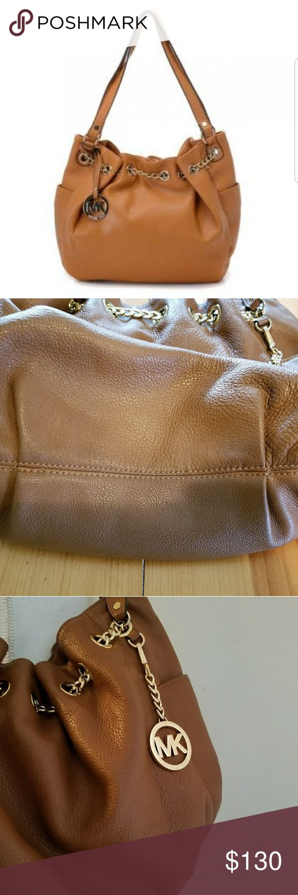 """Michael Kors Bag Beautiful MK Bag with side pockets and gold chain detail. Multiple pockets inside and key chain strap.  Brown in color Approximate measurements  12""""×16"""" Opening 14"""" Michael Kors Bags"""