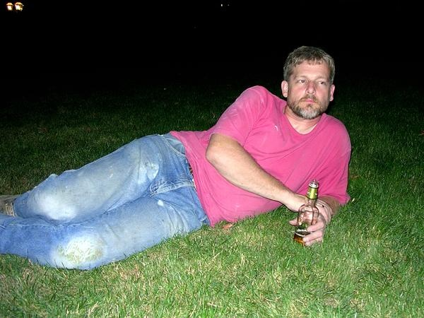 James relaxing in the front yard after work