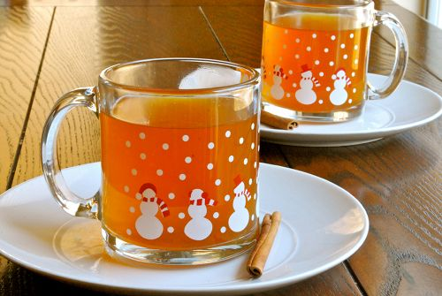 Hot Apple Cider Recipe    2 quarts 100% apple juice  1/2 cup brown sugar  1 apple, unpeeled and cut in half  1 small naval orange, unpeeled and sliced into 1/4-inch slices  2 tsp. whole cloves  2 cinnamon sticks  1/2 tsp. freshly grated nutmeg  1/2 tsp. allspice