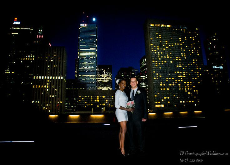 Wedding couple standing on the Podium Green Roof at the Toronto City Hall.