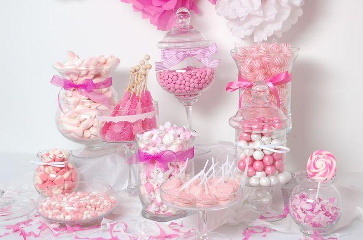 Pink baby shower candy buffet dessert table.