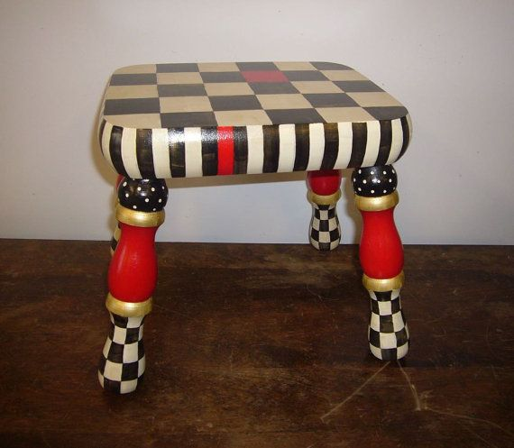 This is a very sturdy step stool that can be used anywhere. It is very stylish in black and white with red accents. It is good for a child but it is painted in a more adult style. it is fun and functional. It is 12 by 18 and 12 inches tall.