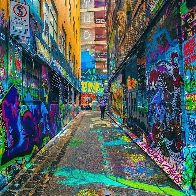 There's plenty of colour to be found on a cloudy day in @visitmelbourne  This is #HosierLane, which is rather famous for its street art; in fact, it's the mishmash of commissioned artworks here that have made the #Melbourne urban art scene renowned across the globe. The vivid array of colours, characters and shapes have been created by local and international artists. If you want to learn more, take a walking tour with an expert local company to get the inside scoop. Photo…