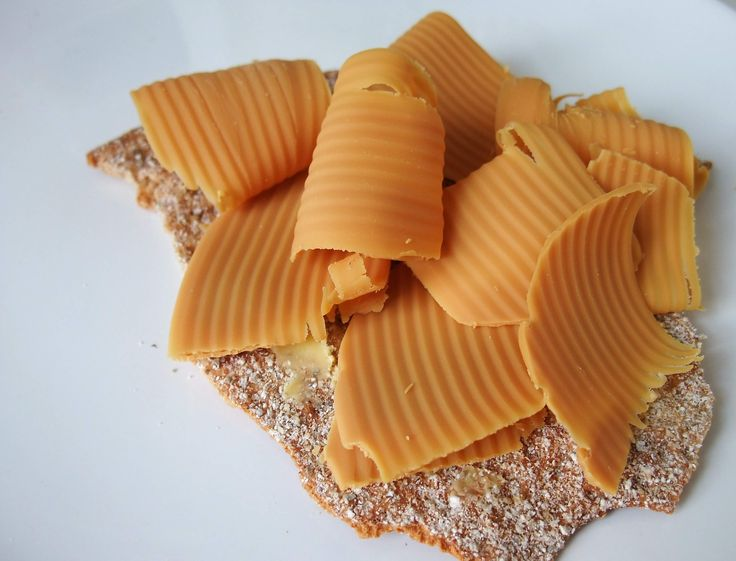 Brunost - Brown cheese with a sweet, yet somewhat sharp flavour with notes of caramel. It is traditionally cut into wafer thin slices with a cheeseslicer and eaten on bread, toast or crisp bread. The cheese is also used in sauces to go with game and venison, often together with juniper berries, and gives such sauces a more subtle, caramel taste.