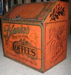 "Vintage ""Blanke's"" large tin coffee bin, slanted and hinged opening, gold and black lettering on orange ground. [Exposition Brand Coffees by G.F. Blanke & Co., St. Louis, Missouri.] circa 1880 - 1910."