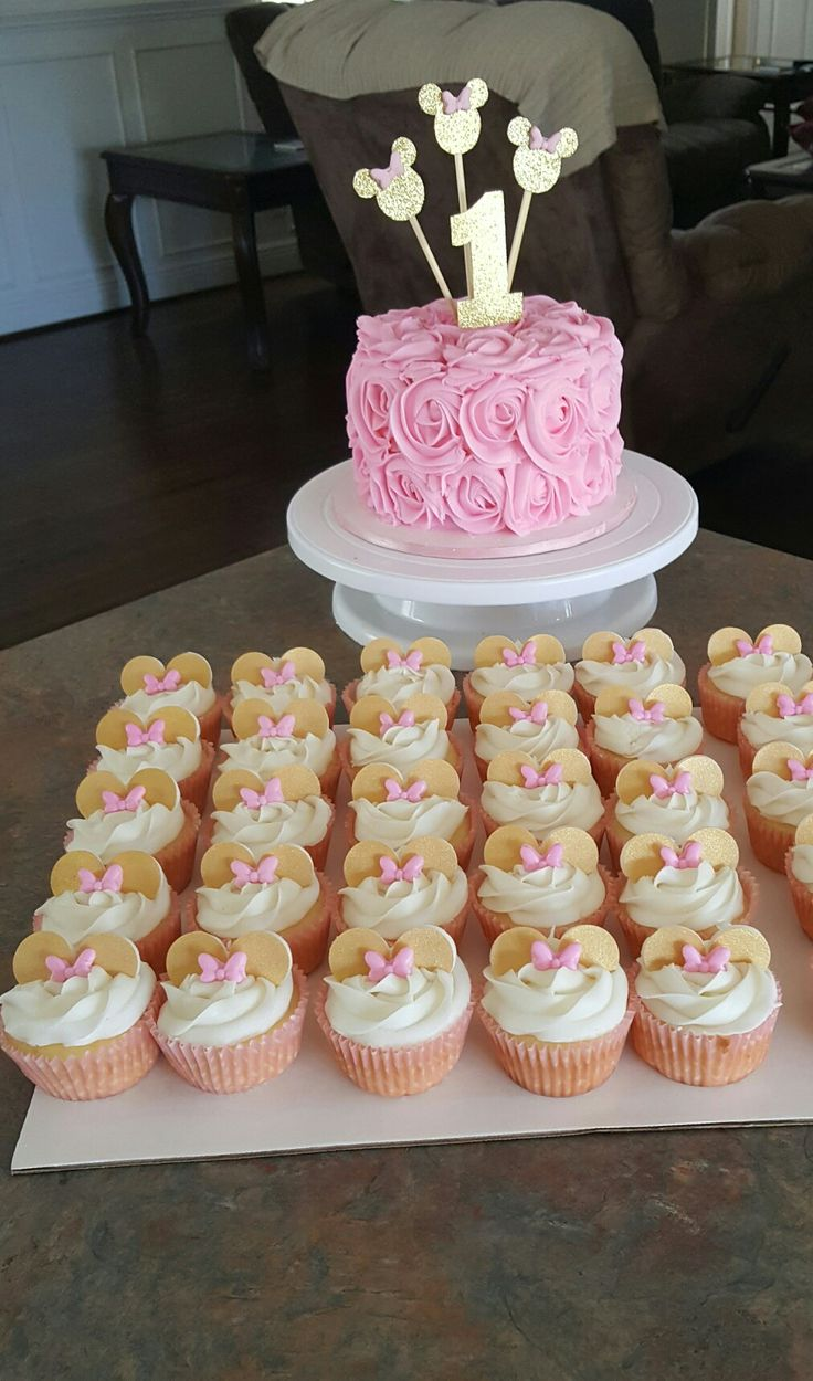 Minnie mouse cupcakes and cake pink and gold