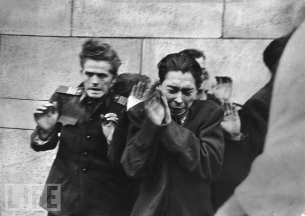 Execution by Hungarian Freedom Fighters of young officers of the Secret Police, Budapest 1956, by John Sadovy