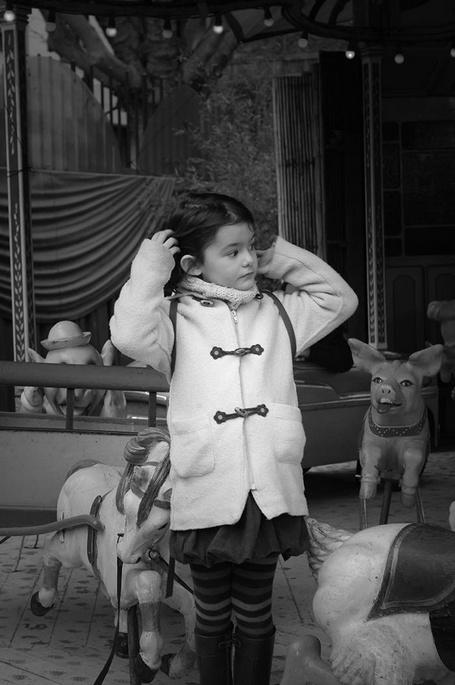 Girl on Carrousel, Paris, France - © Ashley Porciuncula