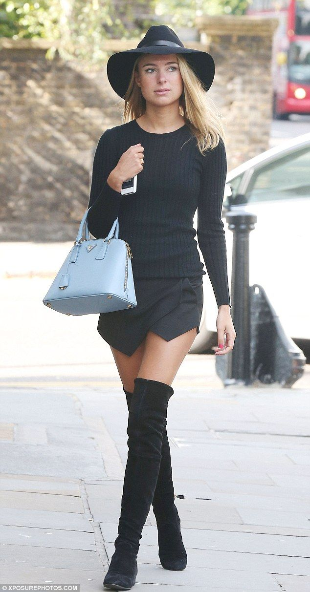 Kimberley Garner.. ZARA mini skorts, blue Prada handbag, with black hat, top, mid-thigh high suede boots..