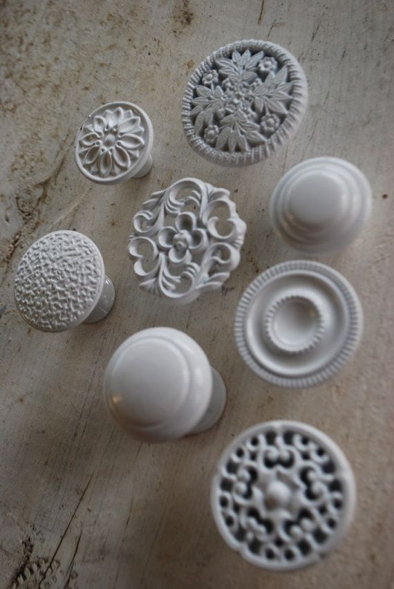 Love the idea of mismatched knobs... White dresser knobs - but we could paint any color