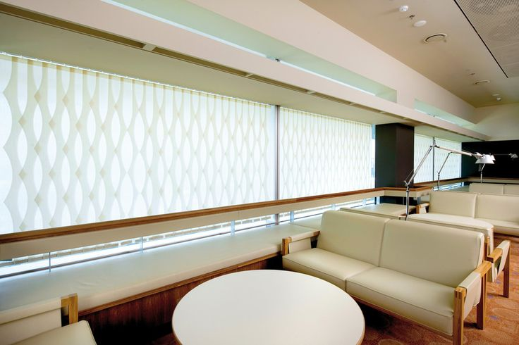 Vertical Blind System with Vertical Wave and Visiotex Fabric in a rest area