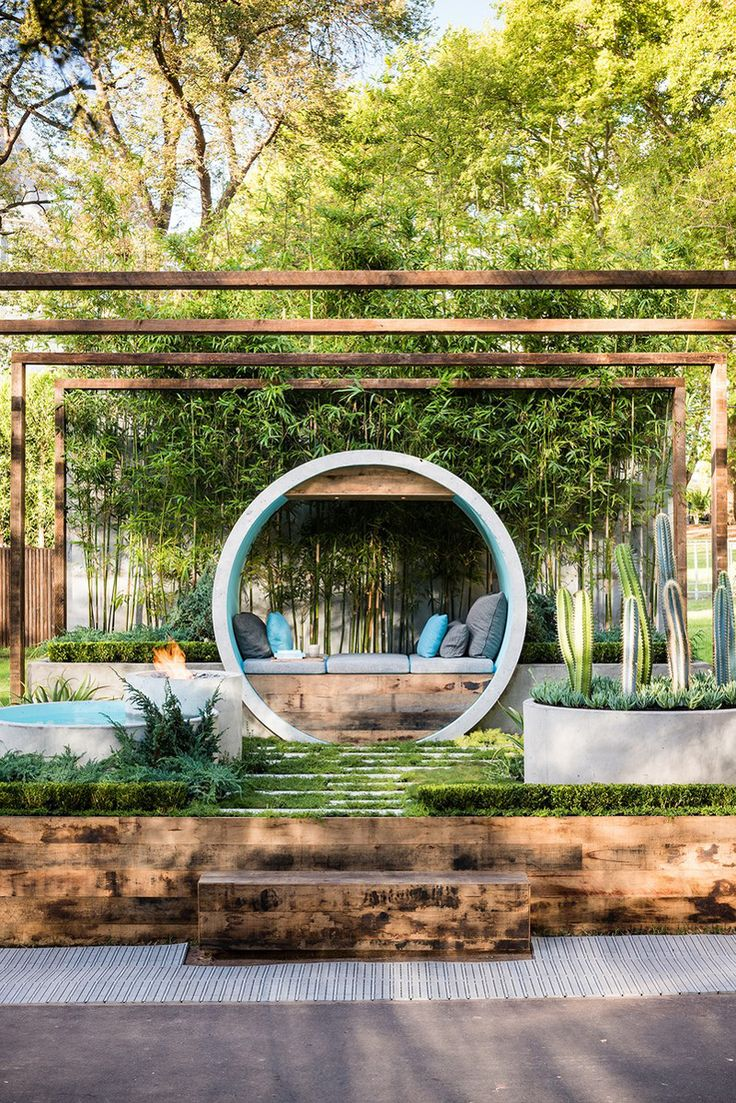 This award winning garden design uses concrete pipes to create seating, a water feature, and a fire pit.