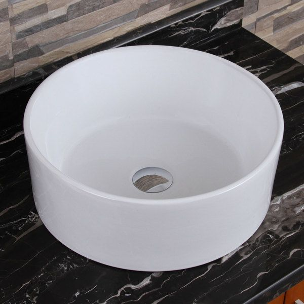 Brush your teeth in style over this round porcelain vessel sink. This bathroom sink features an extra-deep oversized bowl for maximum convenience while spot-cleaning clothes or washing your face. Manu