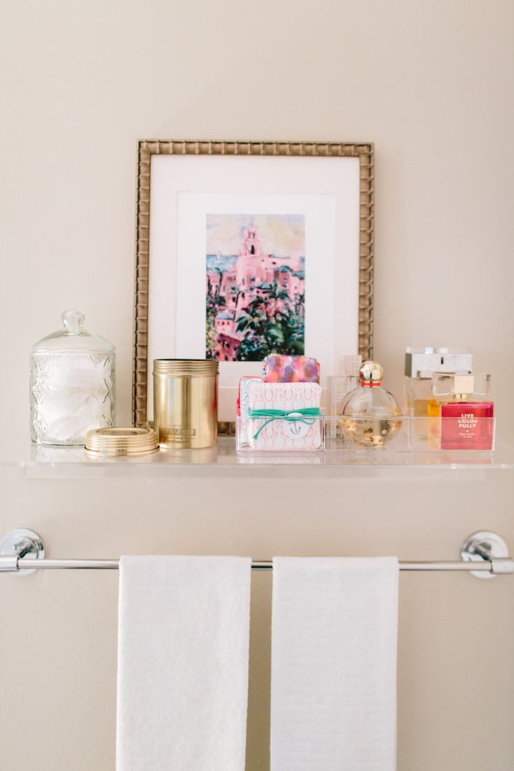 Polka dot bathroom decor - A Whimsical Apartment For Two In Columbia Md Glass Shelf The Container