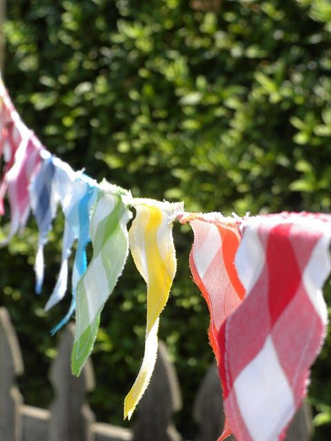 flag bunting - made mine from mom's quilt scraps of plaids, polka dots, and stripes - sewn so the rope is threaded through the top - easily removed for adjustable lengths - so cute -will look for red/white stripes and blue/white stars on sale after the 4th for next year