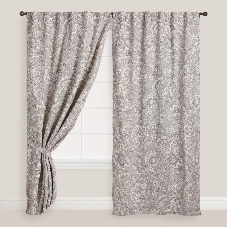 Featuring a traditional Indian floral palampore print on a neutral gray background, our fully lined curtains can be hung as a tab top or sleevetop style for a tailored, versatile look.